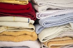 Stacked colorful towels inside a closet. royalty free stock photography