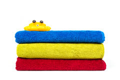 Stacked colorful towels and a shower crab Stock Photography