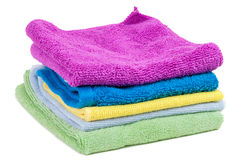 Stacked colorful towels on white background Royalty Free Stock Photo