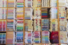 Stacked colorful Turkish towels in shelves. Colorful Turkish towels stored in shelves in a store in turkey royalty free stock photos
