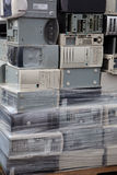 Stacked computers. A load of stacked computers wrapped on a palette going for electronic recycling royalty free stock photos