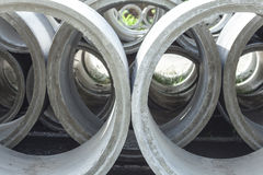 Stacked Concrete Pipe. Pipes made of concrete and cement for heavy industrial use Stock Photo
