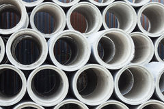 Stacked Concrete Pipe. Pipes made of concrete and cement for heavy industrial use Stock Images