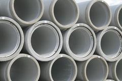 Stacked concrete water pipes. A series of stacked concrete water pipes. Cylindrical and circular in cross section Royalty Free Stock Photo