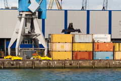 Stacked containers and crane Stock Photography