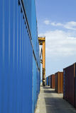Stacked Containers And Crane In Stockyard Stock Photography