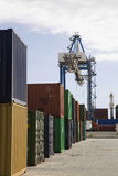 Stacked Containers And Crane In Stockyard Stock Image