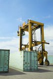 Stacked Containers And Crane In Stockyard Stock Images