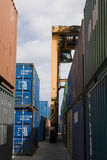 Stacked Containers And Crane In Stockyard Royalty Free Stock Image