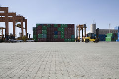 Stacked Containers And Cranes In Stockyard Stock Image