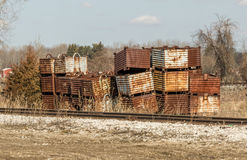 Stacked containers. Unstable rusty steel containers along side of rail road tracks Royalty Free Stock Images