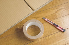Stacked corrugated and adhesive tape. Preparation of the package. Moving preparation Stock Image
