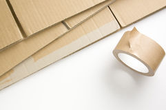 Stacked corrugated and adhesive tape. Preparation of the package. Moving preparation Stock Photos