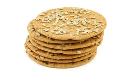Stacked crispy spelt crackers with sunflower seeds Stock Photos