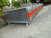 Stacked crowd control barriers. Stacked metal crowd control barriers at the port of Charlestown in Cornwall, England Stock Images