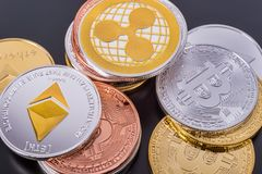 Stacked cryptocurrency coins Bitcoin, Ethereum, Ripple Stock Image