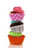 Stacked cupcakes. Stacked colorful cupcakes isolated over white background Royalty Free Stock Photos