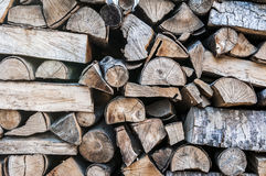 Stacked cut timber. Wood for fireplaces, stacked cut timber Royalty Free Stock Photos