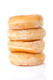 Stacked delicious sugared donuts. Over white background stock photos