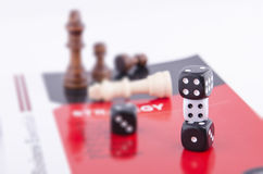 STACKED DICE ON A BOOK IN WHITE BACKGROUND Royalty Free Stock Image