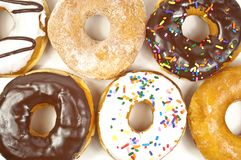 Stacked of different kinds of donuts stock photos