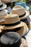 Stacked different kinds of hats and head covers Stock Photography