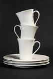 Stacked Dishes. Clean and bright stacked dishes and cups Stock Image