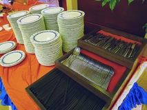 Stacked dishes and fork ,knife,chopsticks Royalty Free Stock Photography