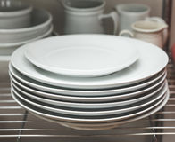 Stacked dishes in kitchen Royalty Free Stock Images