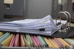 Stacked documents on the office desk. Colorful paper post it the background royalty free stock images