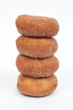 Stacked Donuts. Four sugar and cinnamon donuts, stacked royalty free stock photo