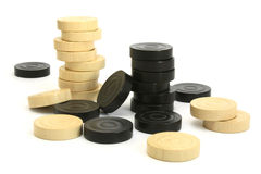 Stacked draught pieces. Stacked draught/checkers/backgammon pieces on a white background Stock Images
