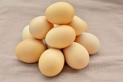 Stacked Egg  On brown sack background. Royalty Free Stock Images