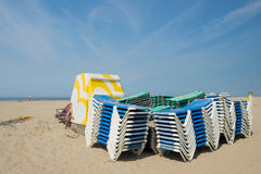 Stacked empty beds at the beach Royalty Free Stock Images