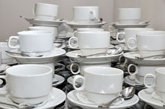 Stacked empty teacups. With teaspoons Royalty Free Stock Photo