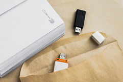 Stacked envelopes and flash drives Stock Photography