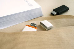 Stacked envelopes and flash drives Royalty Free Stock Images