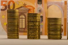 Stacked euro coins against a paper denomination worth fifty euro. S. Euro money.  Currency of the European Union Royalty Free Stock Image