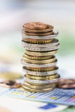 Stacked European Coins. On some banknotes (detailed close-up shot Royalty Free Stock Image