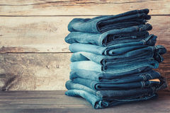 Stacked fashion jeans in store. Stacked fashion blue jeans in store stock image