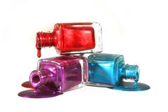 Stacked Fingernail Polish of Red Blue and Purple Stock Photography