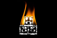 Stacked the fire dice. Dice stacked. Fire on the dice. Clear cube stock photography