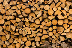 Stacked fire wood background Stock Images