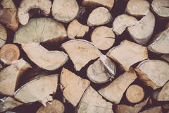 Stacked fire wood in winter stock image