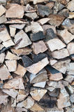 Stacked Firewood. A pile of firewood that has been split and stacked Stock Photo