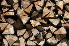 Stacked firewood. Full frame of chopped firewood in a pile Stock Image