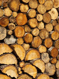 Stacked firewood. Neatly stacked firewood creates intersting pattern Royalty Free Stock Image