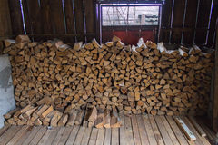 Stacked firewood. Inside a storage room royalty free stock photo