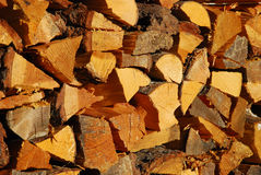 Stacked firewood. Background of stacked firewood or cord Stock Photos