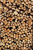 Stacked firewood as background. Stacked heap of firewood as background stock photo